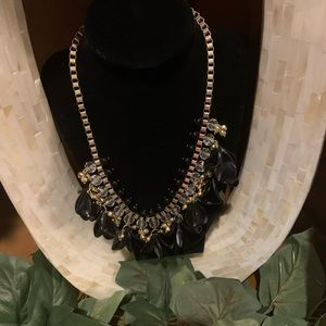 Black and gold petal necklace by INC
